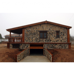 Casa de pìedra y hormigón con sotano